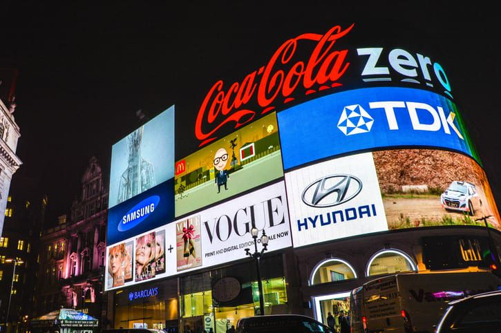 A digital billboard with brand logos.