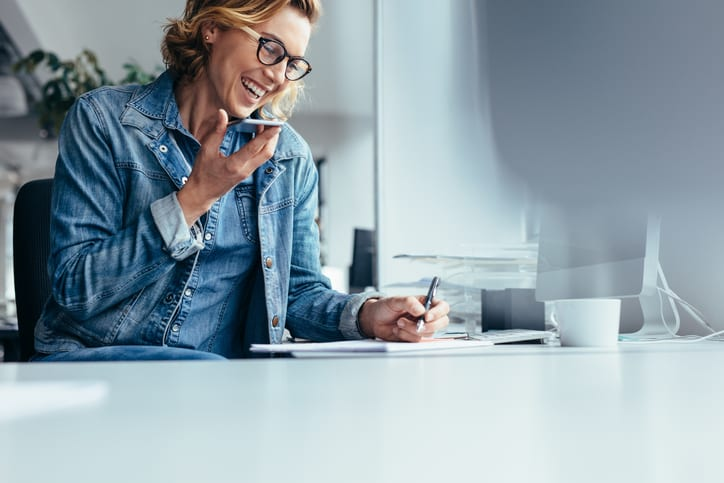 Young female executive working in office.